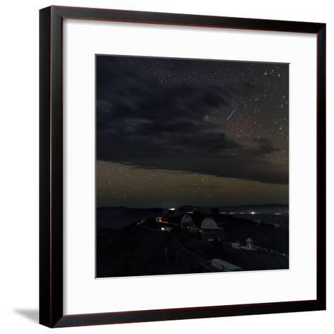 A Meteor Appears Next to the Beehive Star Cluster (M44) Above La Silla Telescope Domes-Babak Tafreshi-Framed Art Print