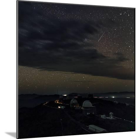 A Meteor Appears Next to the Beehive Star Cluster (M44) Above La Silla Telescope Domes-Babak Tafreshi-Mounted Photographic Print