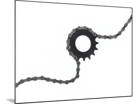 Close Up of a Bicycle Gear and Chain on White-Rebecca Hale-Mounted Photographic Print