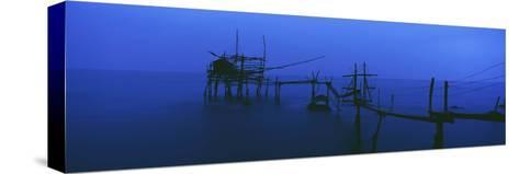 Old Fishing Platform over Water at Dusk-Design Pics Inc-Stretched Canvas Print