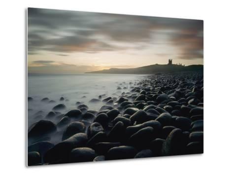Looking Along Boulder Covered Beach Towards Dunstanburgh Castle at Dawn-Design Pics Inc-Metal Print