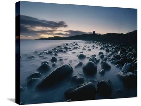 Large Boulders on Beach Near Dunstanburgh Castle at Dawn-Design Pics Inc-Stretched Canvas Print