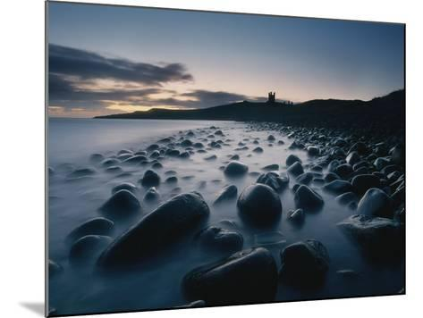 Large Boulders on Beach Near Dunstanburgh Castle at Dawn-Design Pics Inc-Mounted Photographic Print