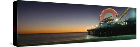 Ferris Wheel and Rollercoaster at Dusk on the Santa Monica Pier-Design Pics Inc-Stretched Canvas Print