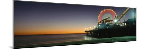 Ferris Wheel and Rollercoaster at Dusk on the Santa Monica Pier-Design Pics Inc-Mounted Photographic Print