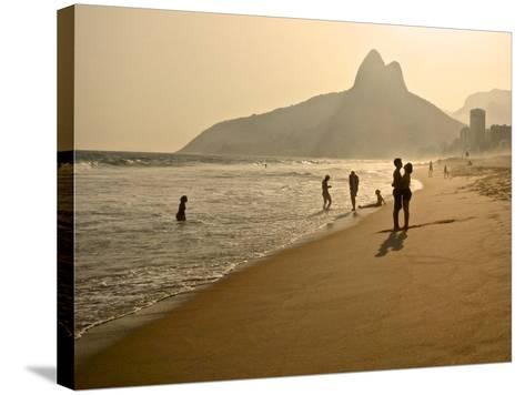 A Couple Embrace on Ipanema Beach as the Sun Sets-Kike Calvo-Stretched Canvas Print