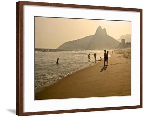 A Couple Embrace on Ipanema Beach as the Sun Sets-Kike Calvo-Framed Art Print