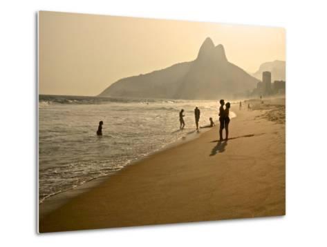 A Couple Embrace on Ipanema Beach as the Sun Sets-Kike Calvo-Metal Print