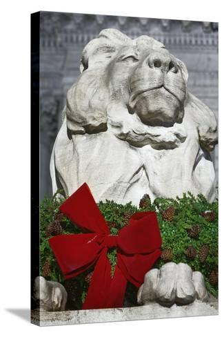 New York Public Library Lion Decorated with a Christmas Wreath during the Holidays.-Jon Hicks-Stretched Canvas Print