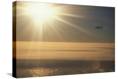 Airplane Flying over Ice-DLILLC-Stretched Canvas Print