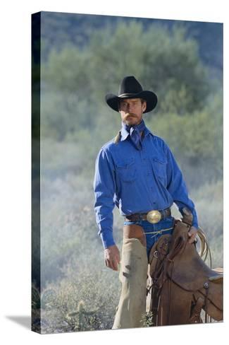 Cowboy with His Saddle-DLILLC-Stretched Canvas Print