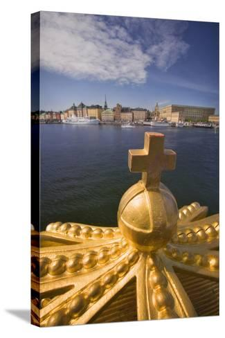 An Ornamental Crown of the Skeppsholmsbron, with Gamla Stan across the Water-Jon Hicks-Stretched Canvas Print