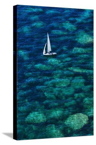 Dinghy off Bonifacio-Jon Hicks-Stretched Canvas Print