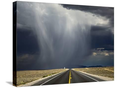 A Storm Crosses Highway 50, 'America's Loneliest Road'.-Jon Hicks-Stretched Canvas Print