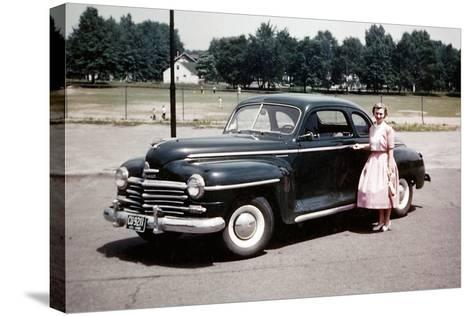 Young Woman Poses with Her Plymouth Automobile, Ca. 1951.-Kirn Vintage Stock-Stretched Canvas Print