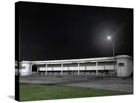 Bus Station at Night-Robert Brook-Stretched Canvas Print