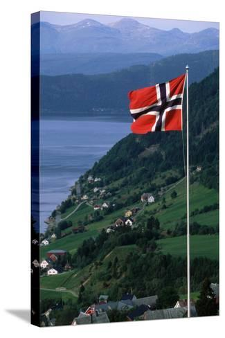 Norwegian Flag Flies above Valley-Paul Souders-Stretched Canvas Print