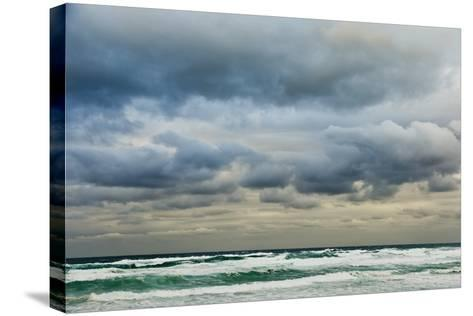 Clouds over Rough Sea-Norbert Schaefer-Stretched Canvas Print