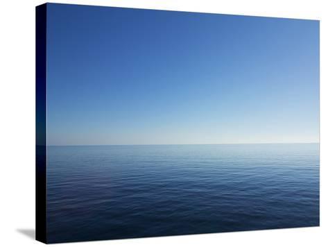 Blue Sky over Calm Sea-Norbert Schaefer-Stretched Canvas Print