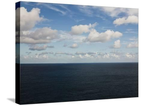 Clouds over Calm Sea-Norbert Schaefer-Stretched Canvas Print