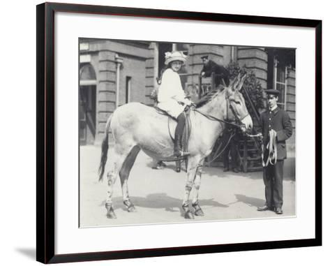 A Young Lady Riding an Ass Which Is Being Led by One Keeper While Another Looks On-Frederick William Bond-Framed Art Print
