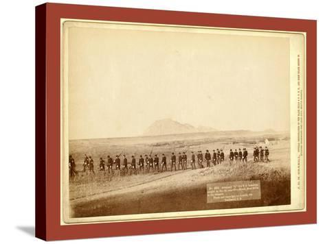 Company C, 3rd U.S. Infantry, Caught on the Fly, Near Fort Meade. Bear Butte in the Distance-John C. H. Grabill-Stretched Canvas Print