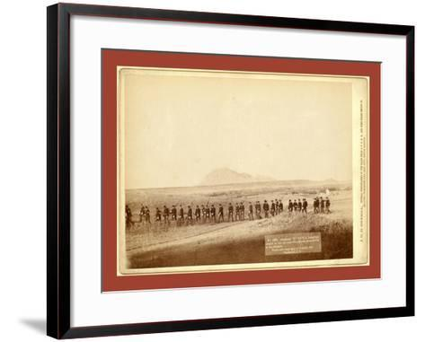 Company C, 3rd U.S. Infantry, Caught on the Fly, Near Fort Meade. Bear Butte in the Distance-John C. H. Grabill-Framed Art Print