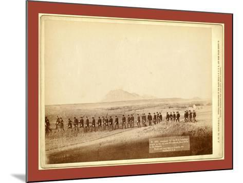 Company C, 3rd U.S. Infantry, Caught on the Fly, Near Fort Meade. Bear Butte in the Distance-John C. H. Grabill-Mounted Giclee Print