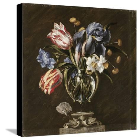 Tulips, Daffodils, Irises and Other Flowers in a Glass Vase on a Sculpted Stand, with a Butterfly-Juan de Arellano-Stretched Canvas Print