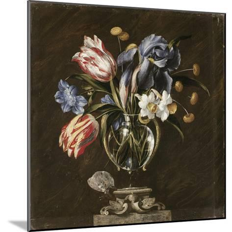 Tulips, Daffodils, Irises and Other Flowers in a Glass Vase on a Sculpted Stand, with a Butterfly-Juan de Arellano-Mounted Giclee Print