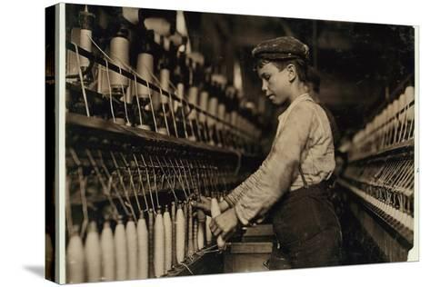A Doffer Replaces Full Bobbins at Globe Cotton Mill, Augusta, Georgia, 1909-Lewis Wickes Hine-Stretched Canvas Print