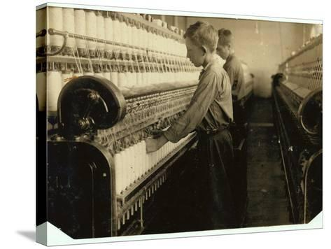 Doffers Replacing Full Bobbins at Indian Orchard Cotton Mill, Massachusetts, 1916-Lewis Wickes Hine-Stretched Canvas Print