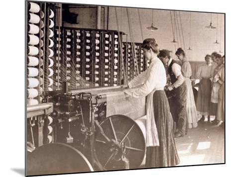 Young Women Working at a Spinning Machine in a Cotton Mill, South Carolina, 1908-Lewis Wickes Hine-Mounted Photographic Print