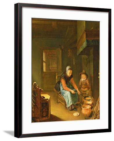 An Interior with a Woman Cooking Pancakes with a Young Boy before a Hearth-Pieter van Slingelandt-Framed Art Print