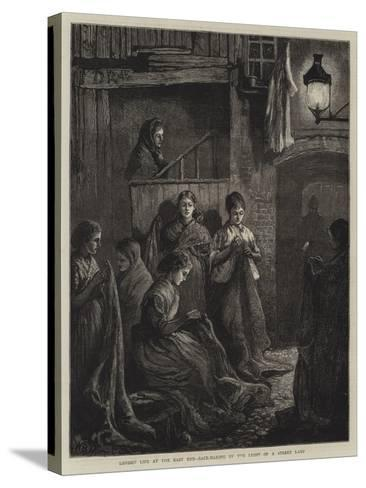 London Life at the East End, Sack-Making by the Light of a Street Lamp-William Bazett Murray-Stretched Canvas Print