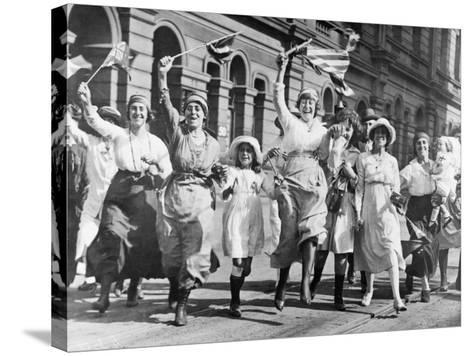 A Group of Women and Children Rejoicing in a Street in Sydney at the Signing of the Armistice--Stretched Canvas Print