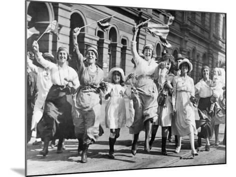 A Group of Women and Children Rejoicing in a Street in Sydney at the Signing of the Armistice--Mounted Photographic Print
