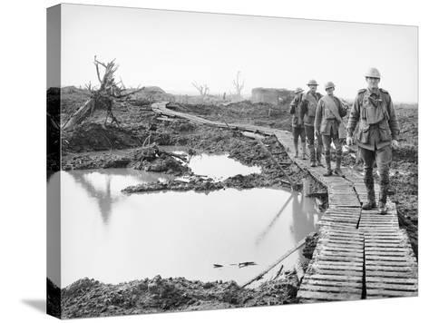 Four Australian Soldiers Walking Along the Duckboard Track at Tokio--Stretched Canvas Print