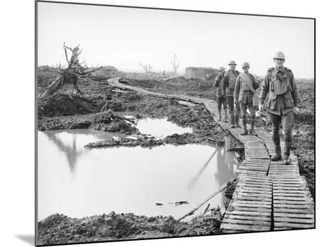 Four Australian Soldiers Walking Along the Duckboard Track at Tokio--Mounted Photographic Print
