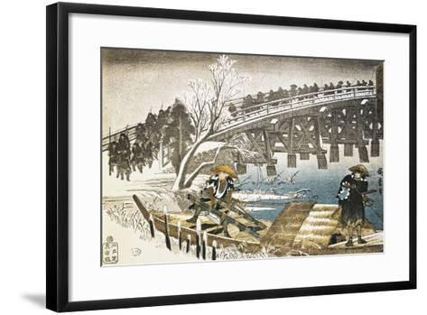 Men in Boat on River with Bridge and Snowy Landscape in Background--Framed Art Print
