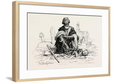 Snake-Charmer. Snake Charming Is the Practice of Pretending to Hypnotise a Snake by Playing an Inst--Framed Art Print
