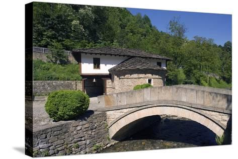 Stone Bridge and Church--Stretched Canvas Print