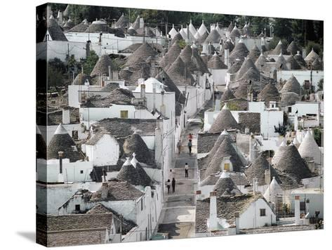 Trulli (Small Round Houses of Stone with Conical Roof) in Alberobello (Unesco World Heritage List--Stretched Canvas Print