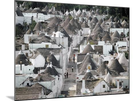 Trulli (Small Round Houses of Stone with Conical Roof) in Alberobello (Unesco World Heritage List--Mounted Photographic Print