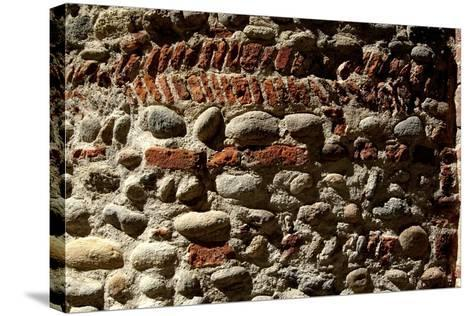 Wall in Stone and Brick Layered in Herringbone Pattern with Thick Layers of Mortar Surviving from R--Stretched Canvas Print