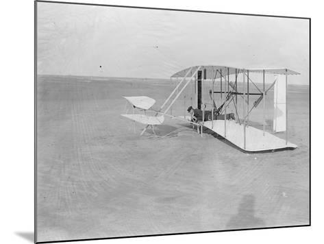 Wilbur in Prone Position in Damaged Machine on Ground after Unsuccessful Trial in North Carolina--Mounted Photographic Print