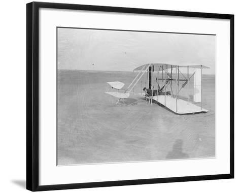 Wilbur in Prone Position in Damaged Machine on Ground after Unsuccessful Trial in North Carolina--Framed Art Print