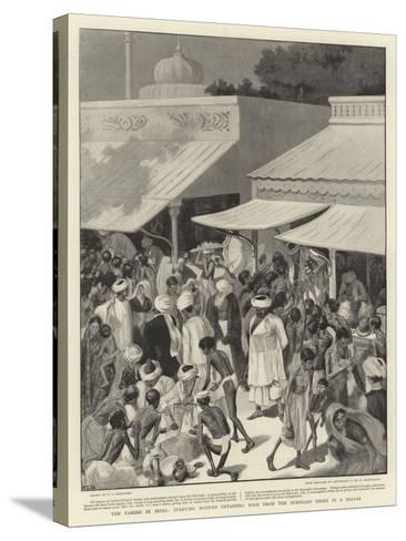The Famine in India, Starving Natives Obtaining Food from the Bunniahs' Shops in a Bazaar--Stretched Canvas Print