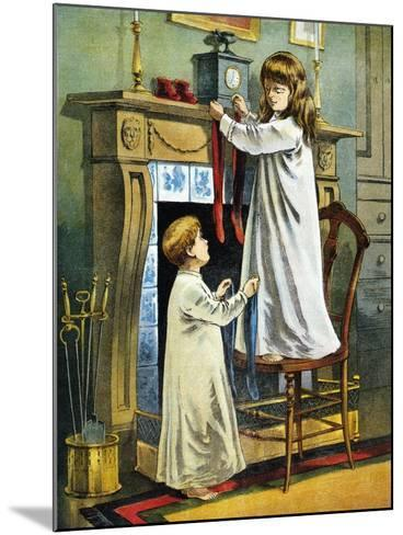 Boy and Girl Place Stockings on their Fireplace Mantle on Christmas Eve, 1918--Mounted Giclee Print