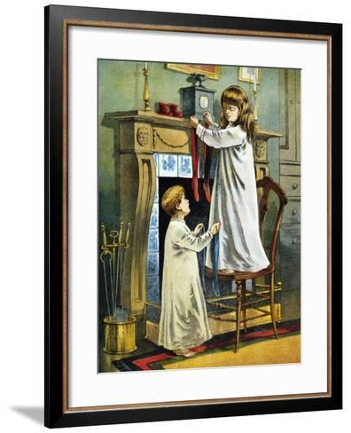 Boy and Girl Place Stockings on their Fireplace Mantle on Christmas Eve, 1918--Framed Art Print